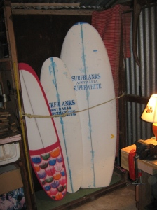 Three boards in various states of completion